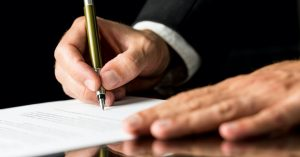 lawyer signing papers