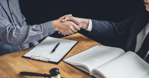 lawyer and client shaking hands