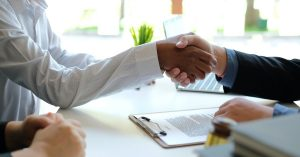 lawyer shaking hands with a client
